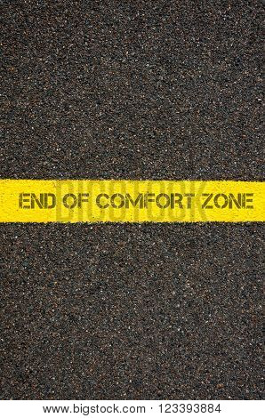 Road marking yellow paint dividing line with words END OF COMFORT ZONE, concept image