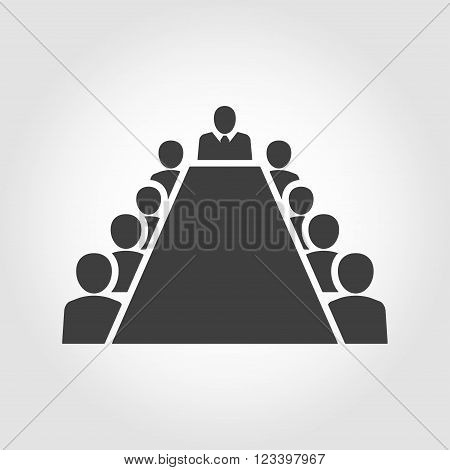 Board room members sitting around a table on grey background