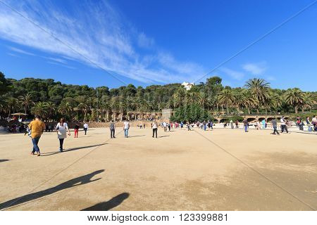 Barcelona, Spain - November 10, 2015: Park Guell main terrace. The Park Guell is a public park system composed of gardens and architectonic elements. The park was built between 1900 and 1914 and was designed by Antoni Gaudi.