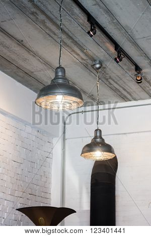 Black ceiling lamp in the room stock photo