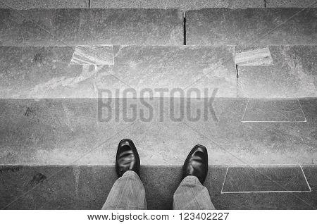 Urbanite Man In Black Shoes On Stone Stairs
