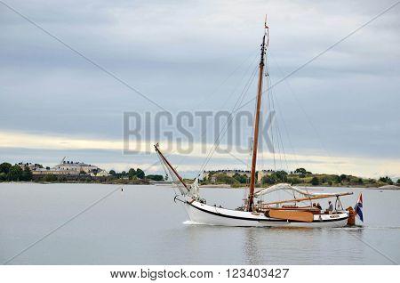 HELSINKI / FINLAND - July 27 2013: Small sailing boat is cruising arround island near the port of Helsinki