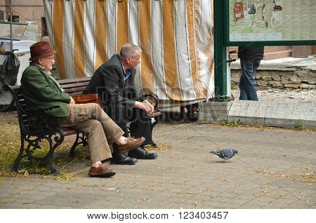 TALLINN / ESTONIA - July 27 2013: Two old-age pensioners seated on the public bench