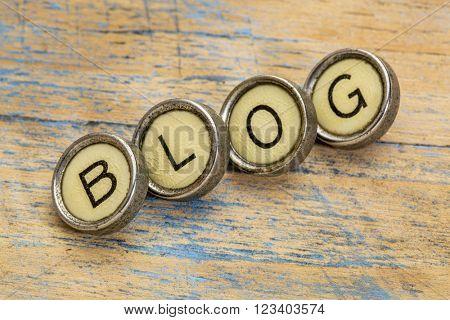 blog word spelt in vintage typewriter keys against grunge wood