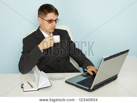 Businessman Reads News Online