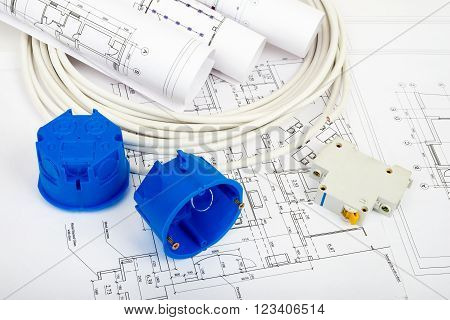 Architecture plan and rolls of blueprints with cabel and blue plastic covers, closeup. Building concept