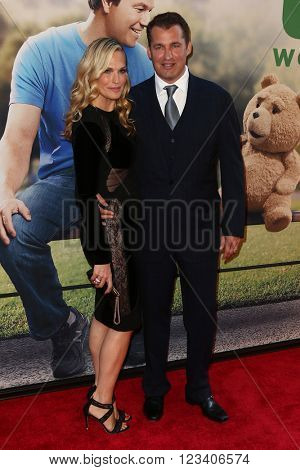 NEW YORK-JUN 24: Molly Sims and Scott Stuber (R) attend the 'Ted 2' world premiere at the Ziegfeld Theatre on June 24, 2015 in New York City.