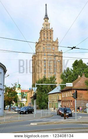 RIGA / LATVIA - July 27 2013: Street in city of Riga with tall building of Latvian Academy of Sciences in background