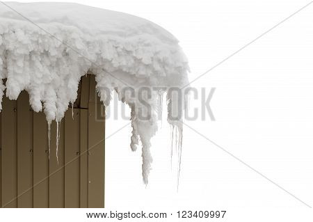 Icicles on the roof in winter isolated on white.