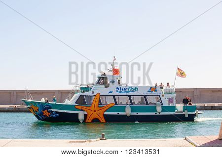 BENALMADENA, SPAIN - MARCH 5, 2016: Touristic boat entering to Puerto Marina Harbor March 5, 2016 in Benalmadena, Spain. Puerto Marina is one of the biggest leisure ports in Andalusia, and is located at Costa del Sol.