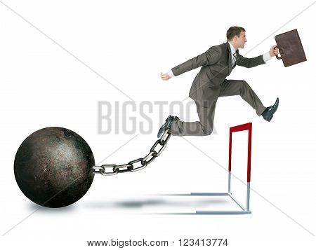 Businessman with irong ball hoppig over barrier isolated on white background, competition concept