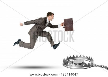 Running businessman with bear trap isolated oon white background