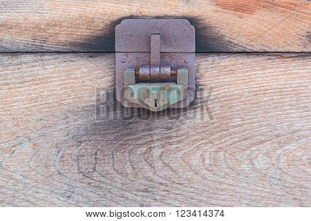 Detail of the lock on an old wooden chest, Close up