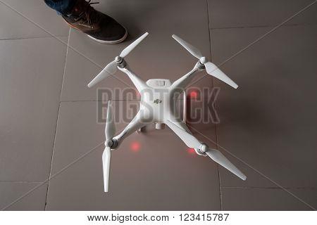 SAINT-PETERSBURG, RUSSIA - FEBRUARY 26: The aircraft - the drone Phantom 4 during setup in Febtuary 26, 2016