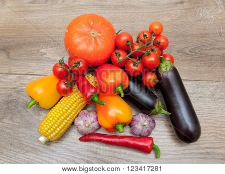ripe vegetables close-up on wooden background. horizontal photo.