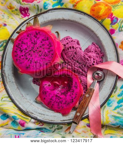 dragonfruit halves in a plate with a spoon