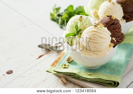 Colorful ive cream scoops in white bowl, copy space ** Note: Shallow depth of field