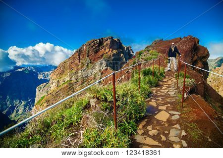 a tourist man standing on the footpath at Pico do Arieiro Madeira Portugal
