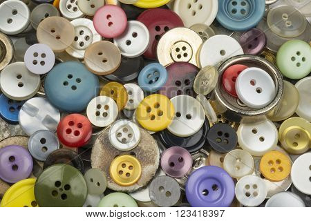 Cheerful collection of colorful round clothing buttons