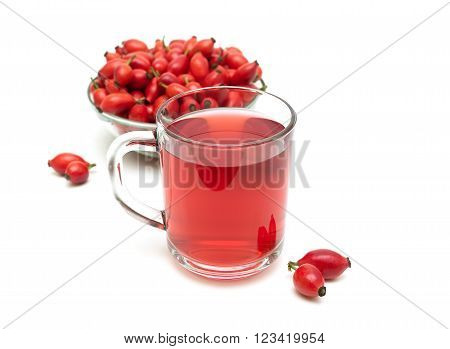 drink and rosehip berries isolated on a white background. horizontal photo.