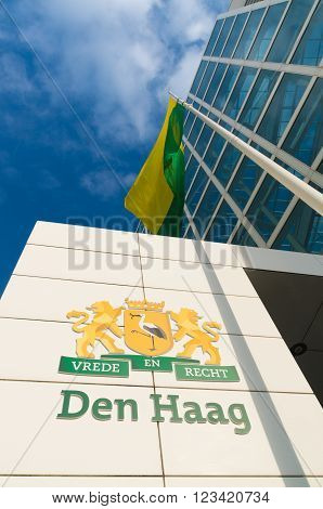 THE HAGUE NETHERLANDS - OCTOBER 3 2015: The Hague city emblem in front of the city hall. The dutch text says piece and justice