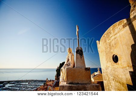 MENTON, FRANCE - SEPTEMBER 20 2013: A female statue at the old russian cemetery