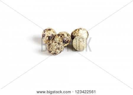 Raw guail eggs isolated on white background