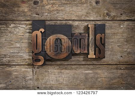 goals, single word set with vintage letterpress printing blocks on rustic wooden background