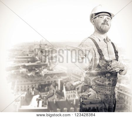 Double Exposure Image of Worker and Cityline