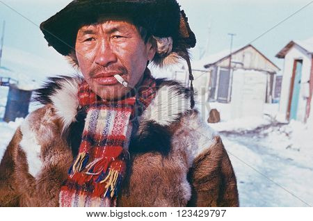 CHUKCHI PENINSULA, USSR - CIRCA MAY, 1985: Portrait of smoking man of indigenous people Chukchi made in Chukchi Peninsula, USSR in May 1985