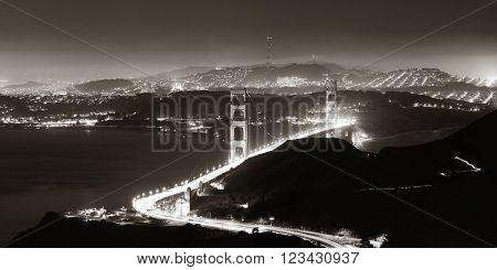 Golden Gate Bridge in San Francisco at night panorama viewed from mountain top