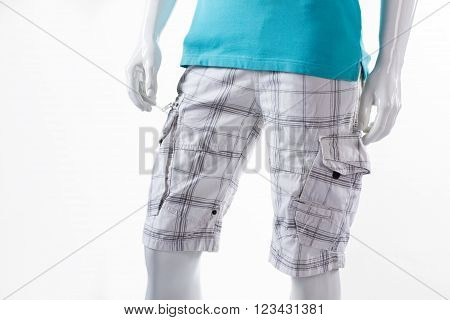 White checkered shorts on mannequin. Male mannequin in cargo shorts. Men's shorts with pockets. Light cotton summer shorts.