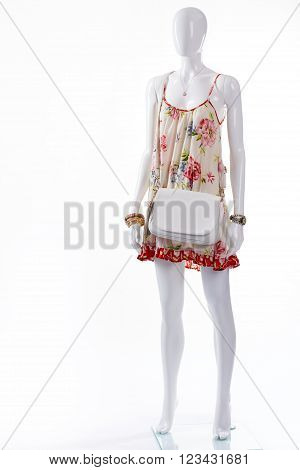 Sarafan with accessories on mannequin. Female mannequin wearing summer outfit. Different accessories and sarafan. Lady's summer outfit with handbag.