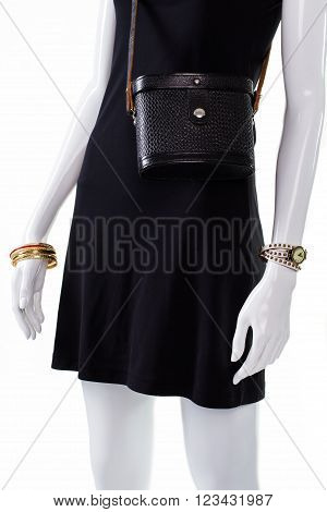 Retro leather purse on mannequin. Female mannequin wearing fashionable bag. Influence of retro era. Lady's compact classy bag.