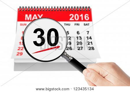 Memorial Day Concept. 30 may 2016 calendar with magnifier on a white background