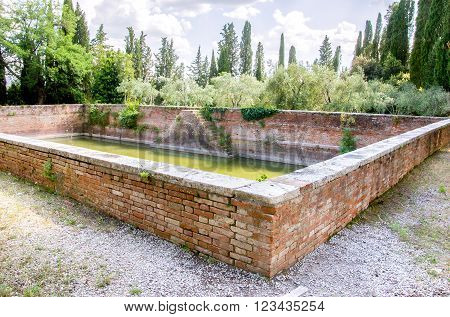 ancient water stock rainwater collection basin inside Monte Oliveto Maggiore complex
