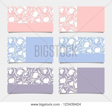 Vector pink, blue and purple business cards with floral pattern.