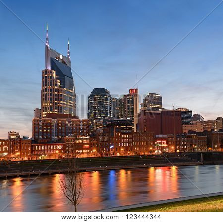 City of Nashville, Tennessee and riverfront at sunset