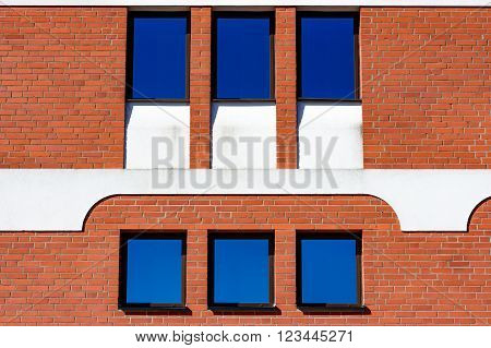Ahus Sweden - March 20 2016: Architectural detail of the Absolut Company factory the place where Absolut Vodka is made. Red bricks with white details.