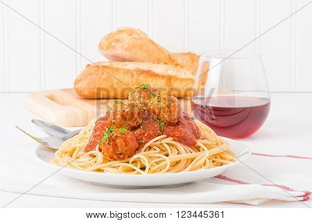 Traditional Italian spaghetti and meatballs served with fresh bread and wine. ** Note: Shallow depth of field