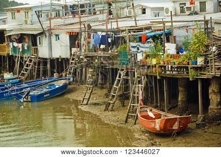 HONG KONG. CHINA - FEBRUARY 11, 2016: Rusty metal constructions of fishermen with riverboats of fishing village Tai O on February 11 2016. Hong Kong dollar is the eighth most traded currency in the world.