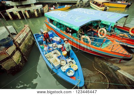 HONG KONG, CHINA - FEBRUARY 11, 2016: Colorful riverboats with fish sellers and some tourists of fishing village Tai O on February 11, 2016. Hong Kong dollar is the eighth most traded currency in the world.