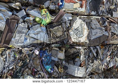Metal scrap garbage compacted for recycling industrial waste