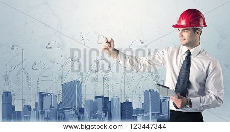 A young architect planning and drawing a happy city sight with blue skyscrapers, sun, clouds
