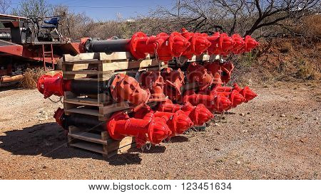 Crate of multiple brand new red fire hydrants to be installed