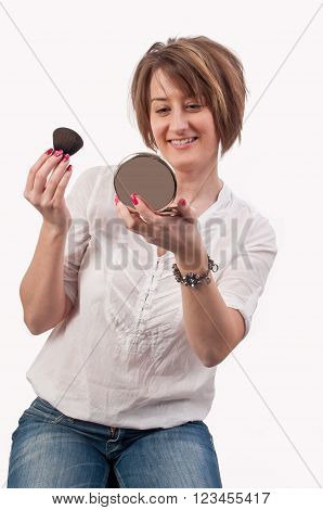 Attractive Young Woman Holding A Brush And Mirror In Her Hands, Getting Ready For Going Out