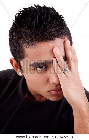 Young Latin Man, Pensive, With His Hand On Front Of Eyes , Isolated On White Background, Studio Shot