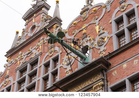 Closeup of the dragon-faced spouts of the Great Arsenal or Great Armoury in Gdansk