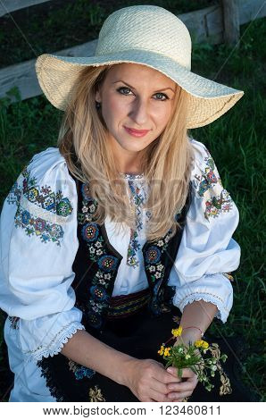 Portrait Of Young Beautiful Singer Posing In Traditional Costume, Romanian Folklore