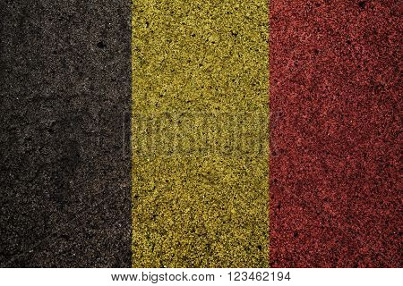 belgium flag with a vintage effect in the background